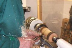 Nick was using wet wood with natural edges, here we can see he is making the first cuts.