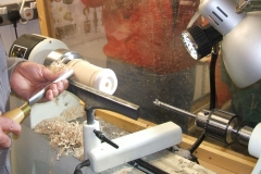 David continues to shape the handle, but you will see a drill bit in the tailstock, this would be used to drill a hole to take the handle of a sealer brush.