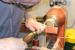 Here Mark is using a ring tool on the inside to give him the shape and quality of cut on the inside.