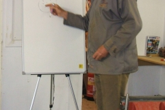Here John is using a sketch on the board to describe some of the growing features that occurs.
