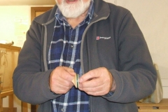 Douglas was also into making wooden toys, here he is showing a small spinning top he had made.