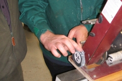 David Hay working on the fibre wheel with a gouge.